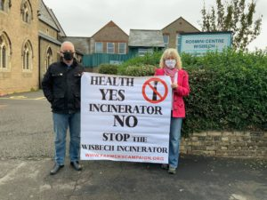 Campaigners with placards against the incinerator, outside venue for consultation